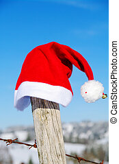 Christmas - Santa Claus Christmas cap outside in a snowy...