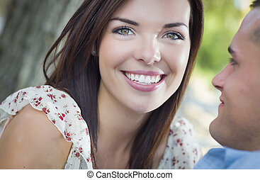 Mixed Race Romantic Couple Portrait in the Park
