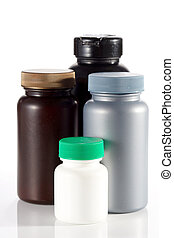Set of blank plastic containers for medicine on white...
