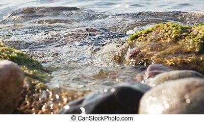 Water waves between stones