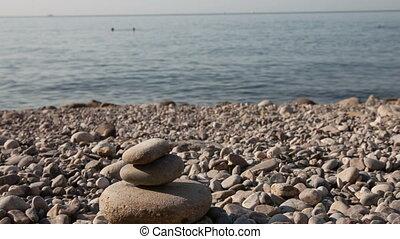 Man building stone pyramid