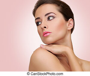 Beautiful woman with health skin looking on empty space...