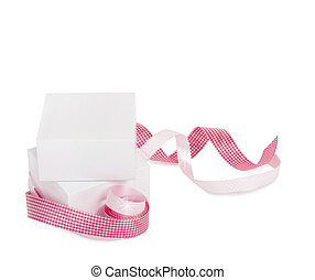 Gift boxes with pink ribbons isolated on a white background