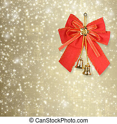 Red Christmas bow with golden bells on an abstract...