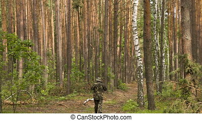 Man in camouflage walking