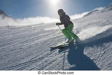 A woman is skiing at a ski resort of Kaprun, Kitzsteinhorn glacier. Austria