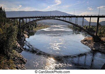 Bridge and Reflection in River - A view of a bridge and it's...