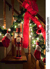 Nutcracker by Christmas garland - Red Nutcracker by a...