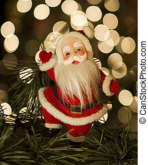 Vintage Santa with Christmas lights in the background