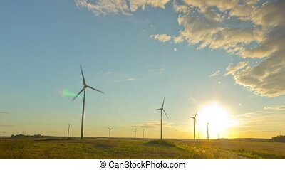 Windmills generators at sunset, tim