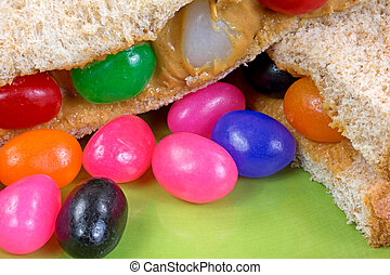 Close view of peanut butter and jelly bean sandwich