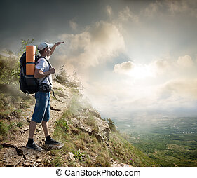 Tourist on the hillside - Tourist with backpack enjoy valley...