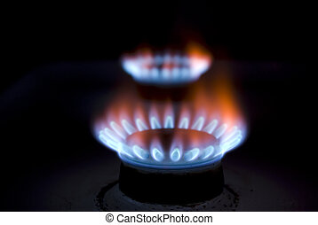 gas - flames of gas stove in the dark