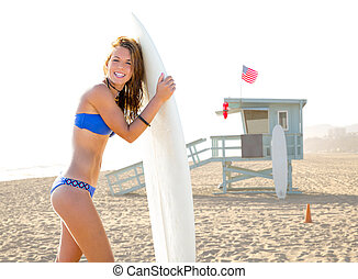 Beautiful surfer teen girl Santa Monica beach California -...