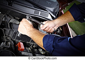 Auto mechanic. - Auto mechanic working in garage. Repair...