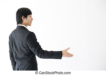 Asian man in suit shaking hands