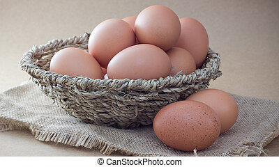 Eggs - Basket with eggs on sackcloth