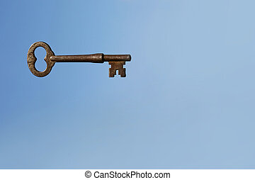 Skeleton Key on Blue Sky Background - Antique Skeleton Key...