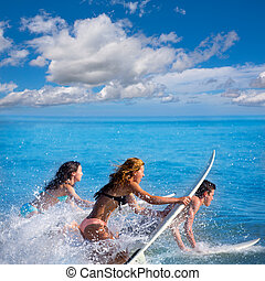Boys and girls teen surfers surfing on surfboards - Boys and...