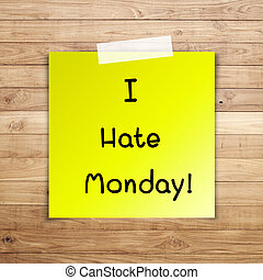 I hate monday on sticky paper on Brown wood plank wall...