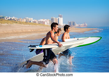 Boys surfers surfing running jumping on surfboards -...