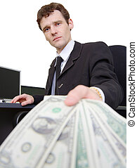 Man and dollars - The man in a business suit stretches...