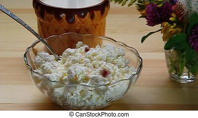 rry cranberries mixed with a spoon with cottage cheese in a...