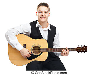 Young man playing on guitar - Young man playing on acoustic...