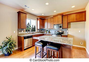 New home kitchen interior with dark brown cabinets.