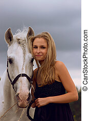 Woman and horse - Blond girl with white horse