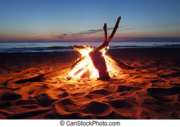 Inviting campfire on the beach along Lake Michigan, USA