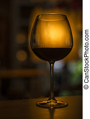 wine glass in cozy dark interior - red wine glass in cozy...