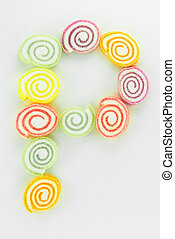 Letter P written with slices of dried sweet candies