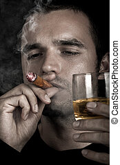 Man smoking cigar - Dark dramatic photo of a man smoking...