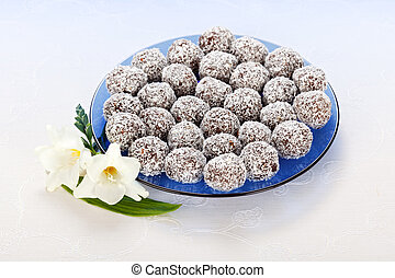 Cakes with grated coconut - Snowball cakes rolled in grated...