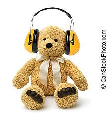 Teddy bear sitting with hear protectors - Teddy bear sitting...
