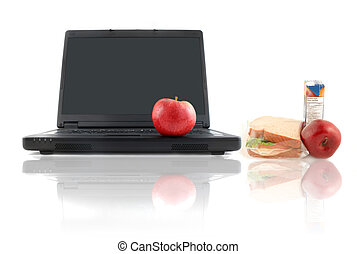 healthy work lunch - a business laptop with shiny red apple...