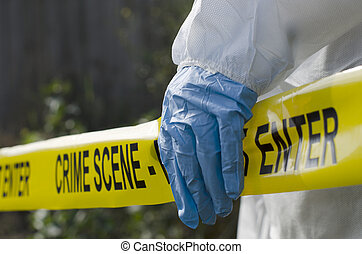 Crime Scene Investigation - Forensic investigator working at...
