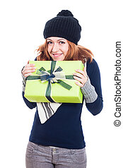 Happy winter woman with present