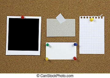 cork notice board with blank photo frame and notes