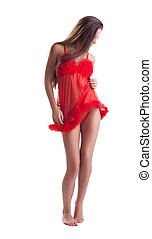 Image of slim young brunette in red negligee, isolated on...