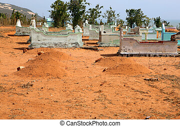Vietnamese cemetery in the desert. Vietnam, near Mui Ne.