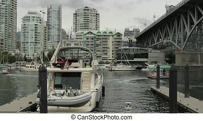 Burrard Inlet in Granville Island - Water Traffic with...