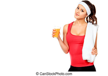 orange juice - Sportive young woman standing after training...