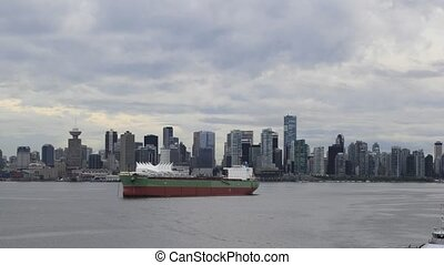 Vancouver BC Canada City Skyline with Moving Clouds and Sea...