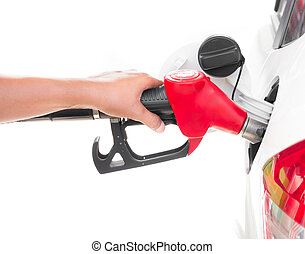 Hand holding gasoline nozzle filling up a car isolated on white