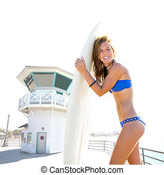 Beautiful surfer teen girl in Huntington beach California -...