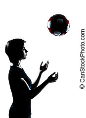 one young teenager girl silhouette tossing soccer football -...