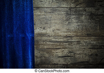 old wooden background with blue paper
