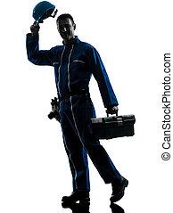 repair man worker saluting silhouette - one caucasian...